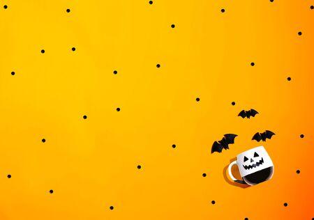 Halloween ghost mug with bats - overhead view flat lay