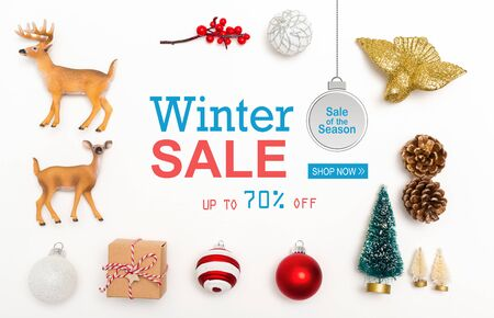 Winter sale message with small Christmas ornaments on a white background