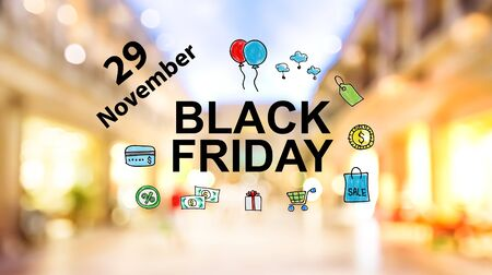 Black Friday November 29 text on blurred illuminated shopping mall background Archivio Fotografico - 130833912