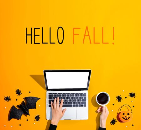 Hello fall message with laptop and Halloween decorations - flat lay Reklamní fotografie