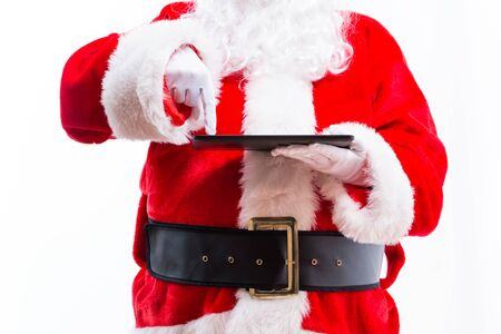 Santa holding a tablet computer isolated on white background
