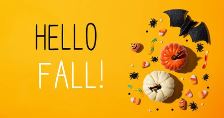 Hello fall message with Halloween theme background - flat lay Reklamní fotografie