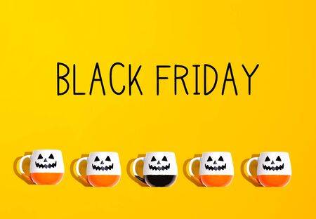 Black Friday banner with Halloween ghost mugs - flat lay