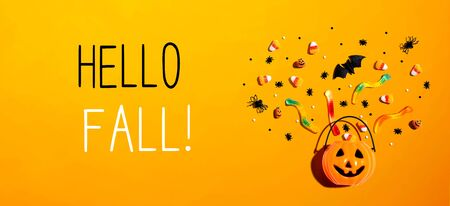 Hello fall message with Halloween pumpkin and decorations