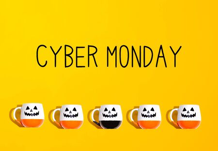 Cyber Monday banner with Halloween ghost mugs - flat lay