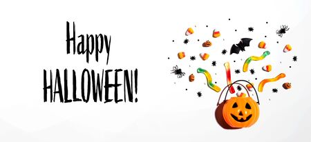 Happy Halloween message with Halloween pumpkin and decorations