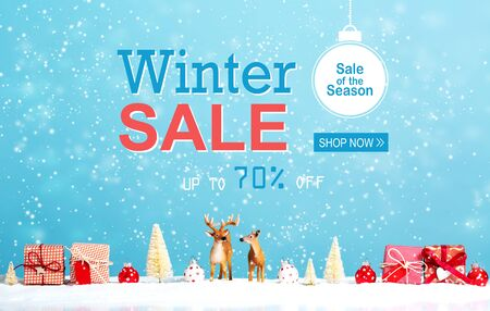 Winter sale message with reindeer and Christmas gifts in snowy day