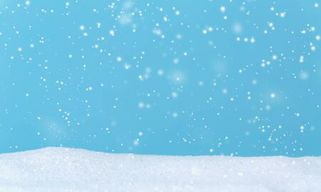 Snowfall over blue sky in a snow covered landscape