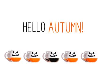 Hello autumn message with Halloween ghost mugs - flat lay