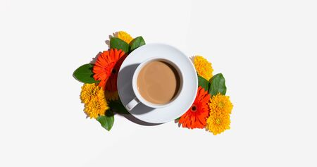 Autumn flower theme with a cup of coffee - overhead view flat lay