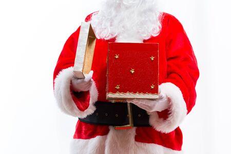 Santa opening a gift box isolated on white background Stock Photo