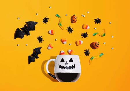Halloween theme with ghost mug - overhead view flat lay