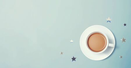 A cup of coffee with little stars - overhead view flat lay
