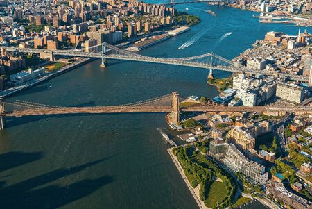 Aerial view of New York City with a view of the Brooklyn and Manhattan Bridges