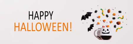 Happy Halloween message with Halloween ghost mug - flat lay Stock Photo