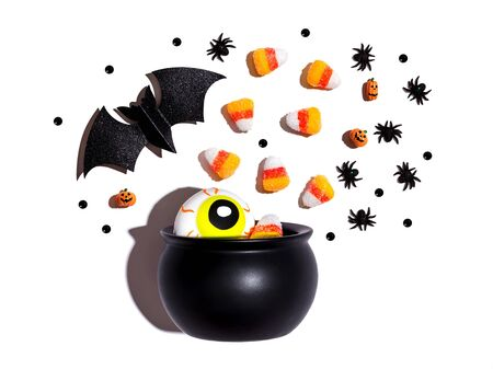 Halloween decorations with witch cauldron - overhead view flat lay Stock Photo