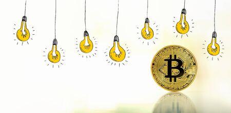 Idea light bulbs with gold bitcoin cryptocurrency coin