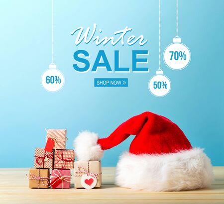Winter sale message with a Santa hat and tiny Christmas gift boxes