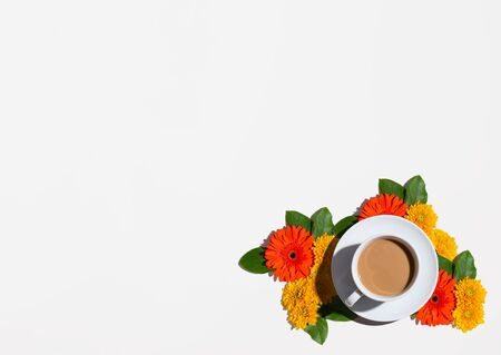Autumn flower theme with a cup of coffee- overhead view flat lay