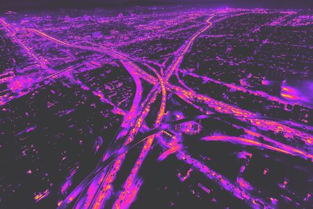 Aerial view of a massive highway in Los Angeles, CA at night synth wave style