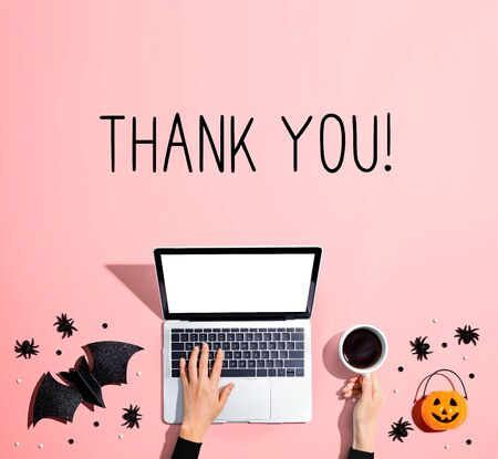 Thank you message with laptop and Halloween decorations - flat lay