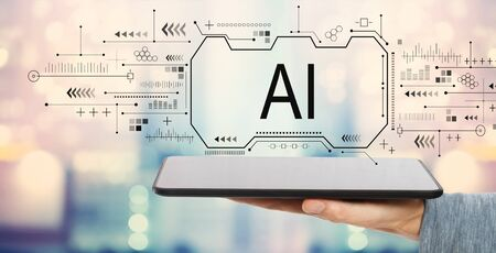 AI concept with man holding a tablet computer 스톡 콘텐츠