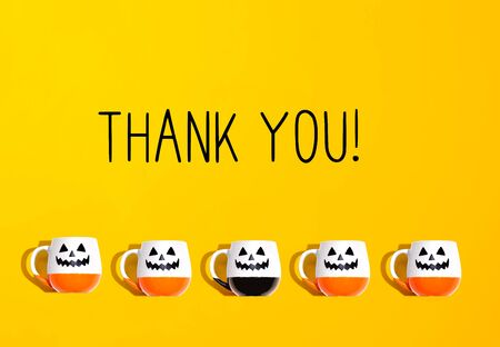 Thank you message with Halloween ghost mugs - flat lay