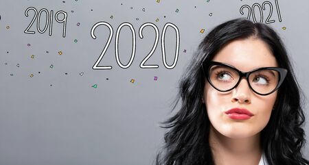 2020 with young businesswoman in a thoughtful face