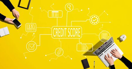 Credit score theme with people working together with laptop and phone