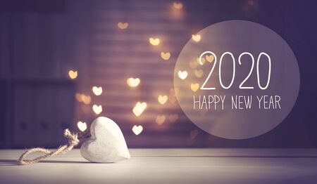 New Year 2020 message with a white heart with heart shaped lights