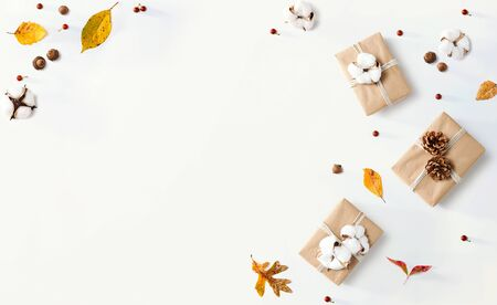 Gift boxes with autumn theme - overhead view flat lay Stock Photo