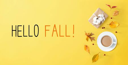 Hello fall message with autumn theme with coffee and gift box