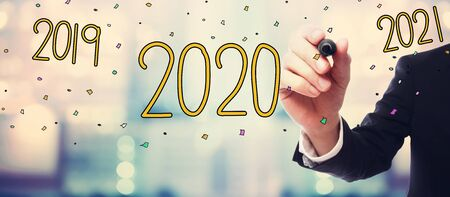 2020 concept with businessman on blurred abstract background Reklamní fotografie