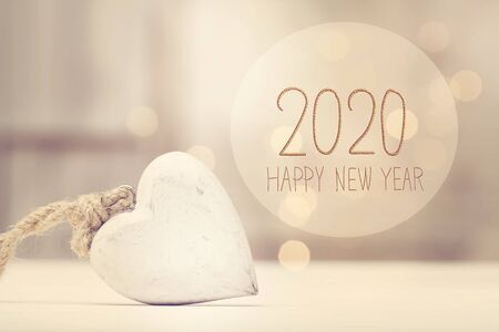 New Year 2020 message with a white heart in a room