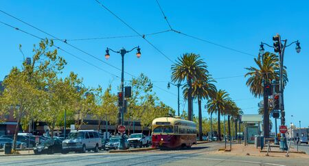 SAN FRANCISCO- MAY 1st 2019: Trolleys pass through the Embarcader in San Francisco, CA Editorial