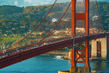 Traffic passes over San Franciscos Golden Gate Bridge from Marin County