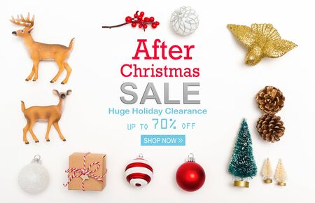 After Christmas sale message with small Christmas ornaments on a white background Stock Photo