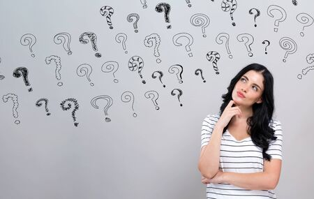 Small question marks with young woman in a thoughtful face