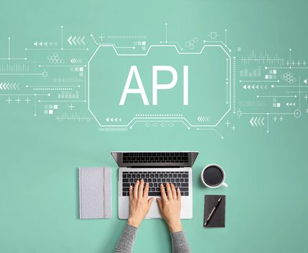 API concept with person using a laptop