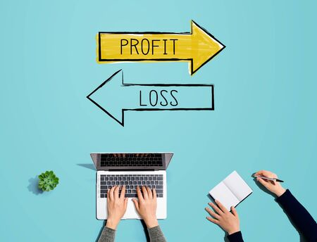 Profit or loss with people working together with laptop and notebook