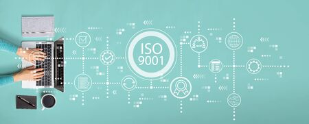 ISO 9001 concept with person using a laptop