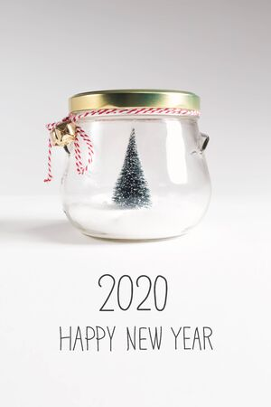 2020 Happy New Year message with Christmas tree in a glass Jar