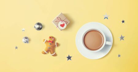 Christmas ornaments with a cup of coffee - flat lay
