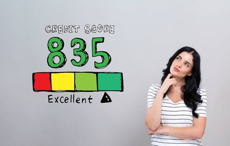 Excellent credit score theme with young woman in a thoughtful face