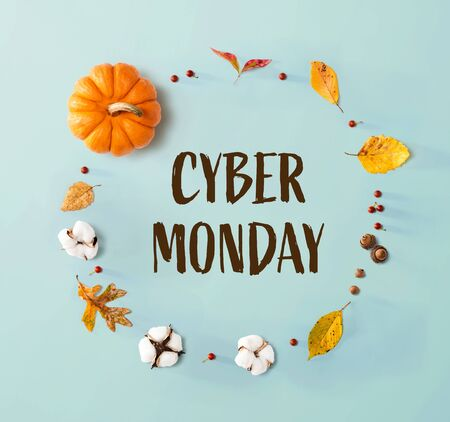 Cyber Monday banner with autumn leaves and an orange pumpkin