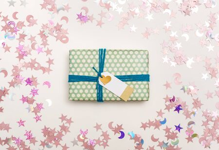 A gift box with confetti on a white 写真素材