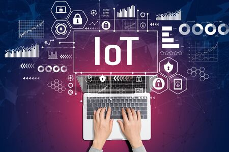 IoT theme with person using a laptop computer