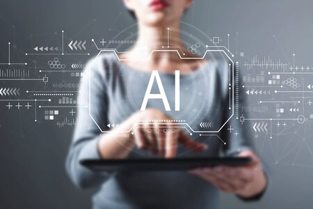 AI concept with business woman using a tablet computer