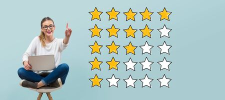 Rating with yellow stars with young woman using her laptop