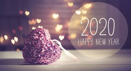 New Year 2020 message with a pink heart with heart shaped lights Imagens